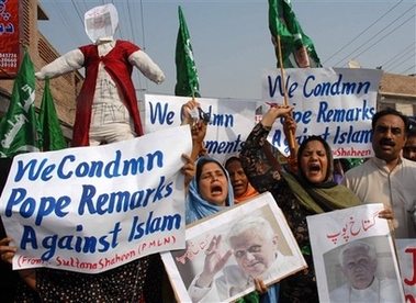 Pakistani protesters hold a rally to condemn Pope Benedict XVI for his remarks about Islam which hurt the sentiments of Muslims, Thursday, Sept. 21, 2006 in Multan, Pakistan. Protesters continued to demand that Pope apologize fully for his remarks on Islam and violence. (AP Photo/Khalid Tanveer)